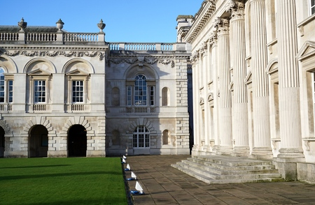 CAMBRIDGE, UK - FEBRUARY 7 2016: The neoclassical columned buildings of the Cambridge University Senate House sit beneath blue skies. Editorial