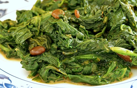 Close up view of the traditional Chinese vegetable side dish of spinach cooked with fermented tofu Stock Photo