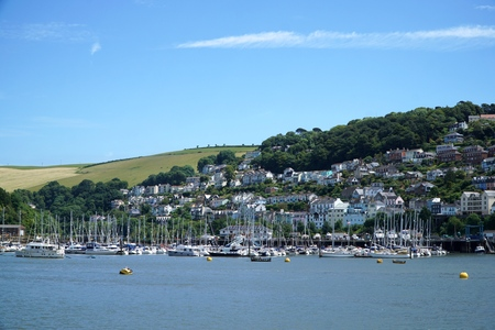 Dozens of boats and small yachts sit moored at the Darthaven Marina, Kingswear, Devon, opposite the popular coastal town of Dartmouth on the River Dart.