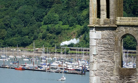 hams: A passenger steam train carries tourists on a scenic voyage along the banks of the River Dart in the South Hams, Devon, England.