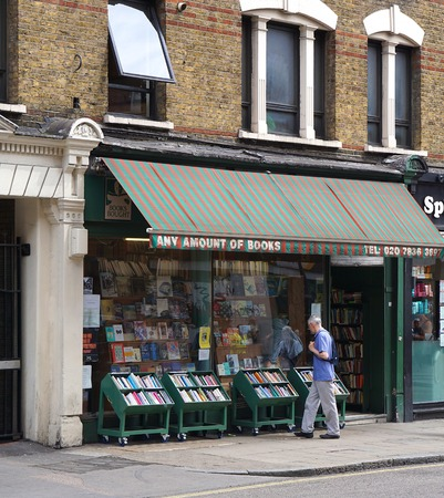 browses: LONDON, UK - JULY 25 2016: A man browses a display of books outside an independent book shop in London, England.