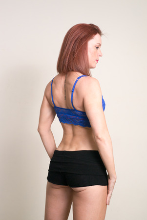 hot ass: Red headed fitness woman wearing sexy clothes and exposing her trained ass