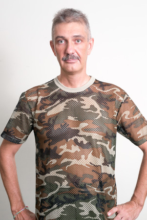 one mature man only: Older Caucasian man with mustache wearing army style t shirt
