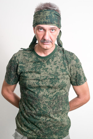 one mature man only: Older Caucasian man with mustache wearing soldier outfit ready to airsoft action Stock Photo