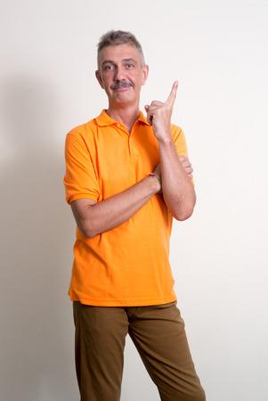 empleadas domesticas: Older Caucasian man with mustache wearing orange shirt vertical studio shot