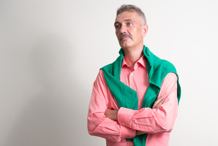 only one senior adult man: Older Caucasian man with mustache horizontal studio shot