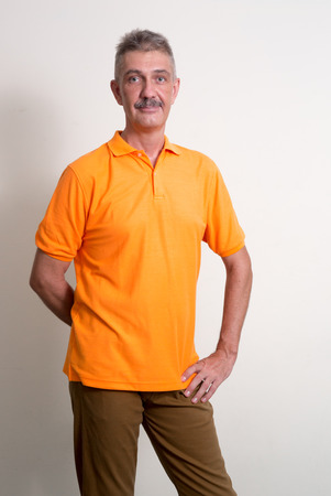 one mature man only: Older man with mustache vertical studio shot