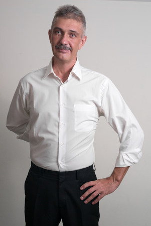 one mature man only: Older man with mustache wearing casual business style vertical studio shot