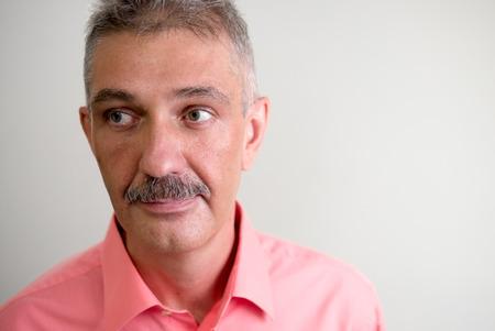and the horizontal man: Older man with mustache horizontal studio shot