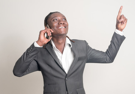 only one mid adult man: African man using smart phone Stock Photo