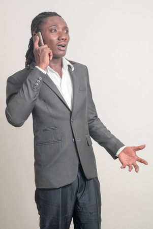 dissapointed: African man using smart phone Stock Photo