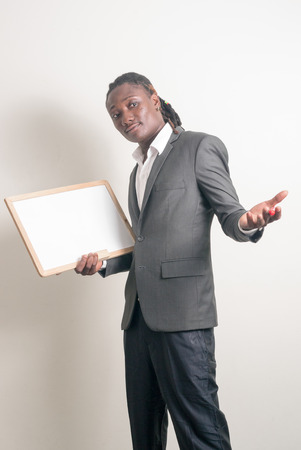 only mid adult men: African man holding board Stock Photo