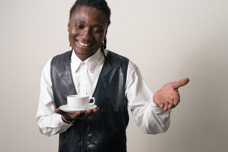 incidental people: Black waiter smiling Stock Photo