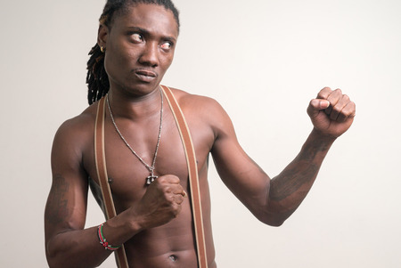 partially nude: Portrait of African boxer
