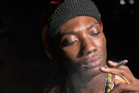jamaican adult: African man smoking