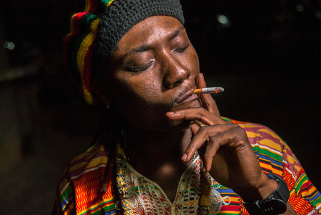 jamaican adult: African man smoking