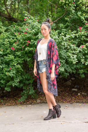 chinese ethnicity: Young beautiful woman from Chinese ethnicity standing outdoors