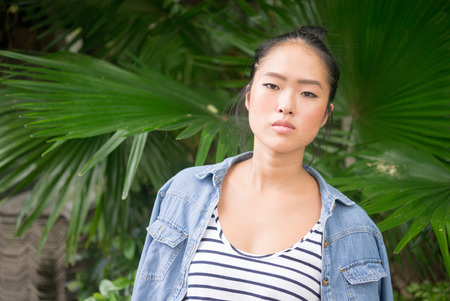 chinese ethnicity: Young beautiful Chinese ethnicity hipster woman outdoors