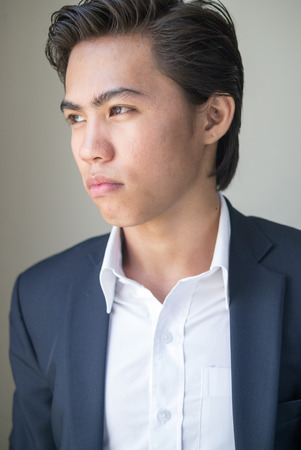 filipino adult: Portrait of young Asian businessman