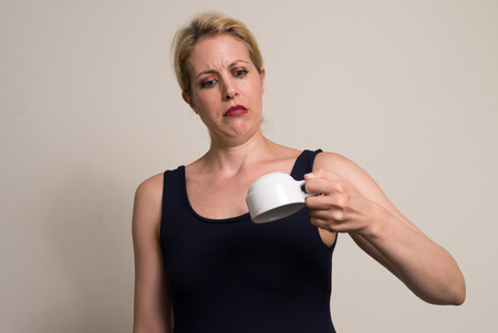 dissapointed: Portrait of woman holding coffee cup
