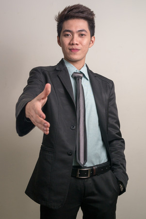 filipino ethnicity: Asian young businessman offering his hand