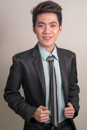 filipino ethnicity: Portrait of Asian young businessman Stock Photo