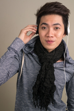 filipino ethnicity: Young asian man using headphones Stock Photo
