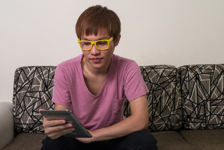 one mid adult male: Asian young man using digital tablet