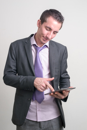 only one mid adult man: Businessman using digital tablet