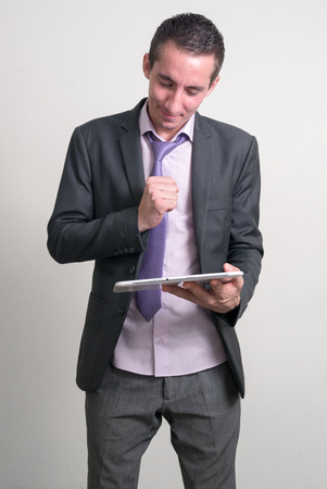 one mid adult man only: Businessman using digital tablet