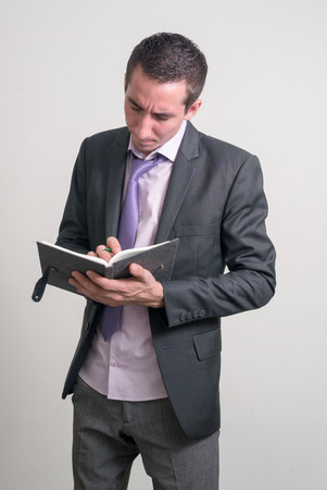only one mid adult male: Man holding book