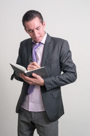 only one mid adult man: Man holding book