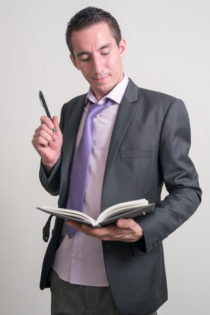 only mid adult men: Man holding book