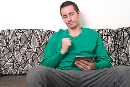 one mid adult man only: Man sitting and using digital tablet