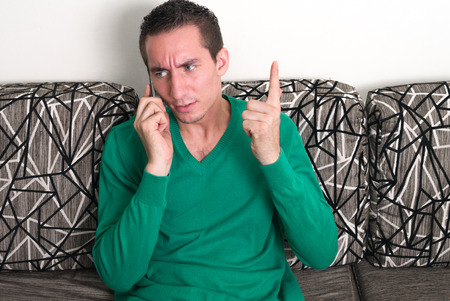 only one mid adult male: Man sitting and using phone Stock Photo
