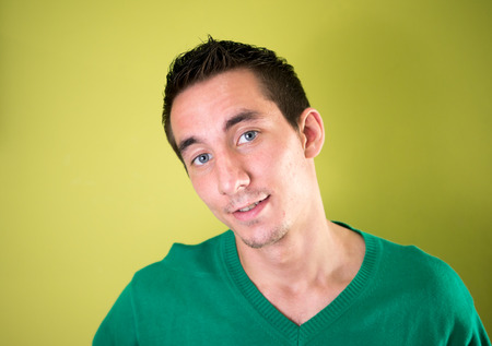 only mid adult men: Portrait of man against yellow background