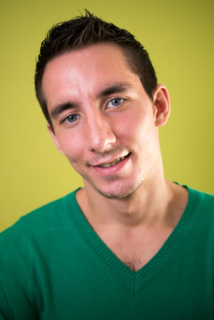 only one mid adult male: Portrait of man against yellow background
