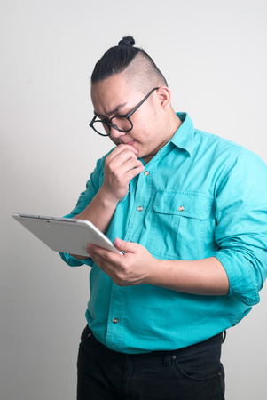 only mid adult men: Overweight Asian man using digital tablet Stock Photo