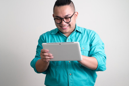 one mid adult man only: Overweight Asian man using digital tablet Stock Photo