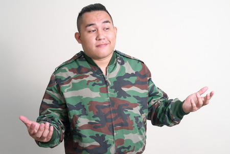 only one mid adult male: Portrait of overweight Asian man