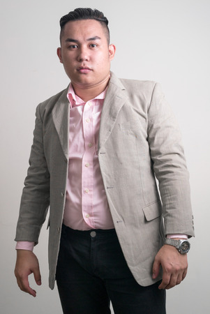 one mid adult male: Portrait of overweight Asian man