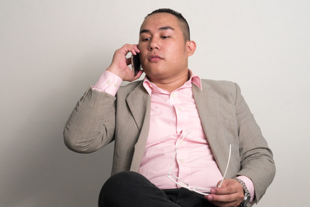 one mid adult male: Portrait of Asian overweight man