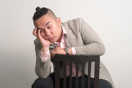 only one mid adult male: Portrait of Asian overweight man