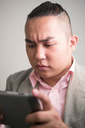 one mid adult man only: Overweight man using phone Stock Photo