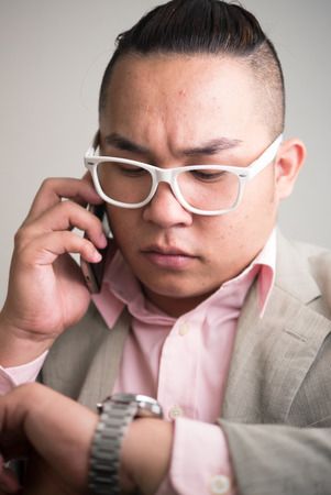 filipino ethnicity: Overweight man using phone Stock Photo