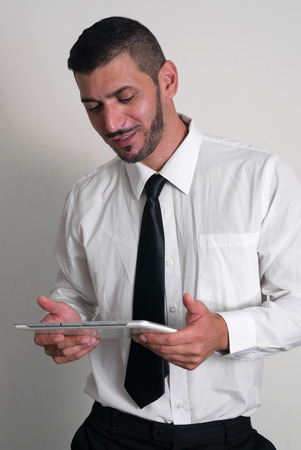 only one mid adult male: Man using digital tablet