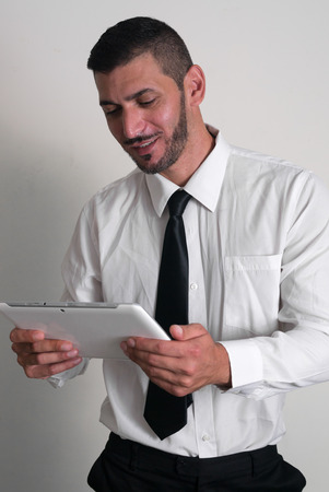 only one mid adult man: Man using digital tablet
