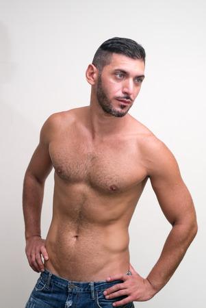 partially nude: Portrait of partially nude man