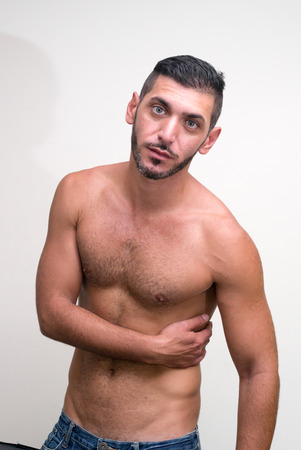 partially nude: Handsome shirtless man