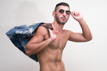 partially nude: Portrait of handsome man wearing sunglasses